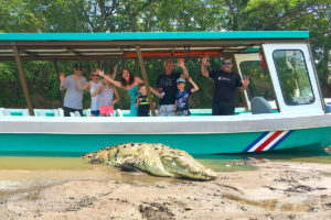 Happy tour visitors and a crocodile up-close!