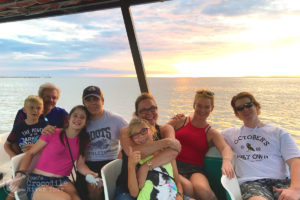 Happy family sunset photo from our boat