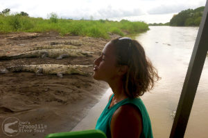 Professional surfer Emily Gussoni with a crocodile kiss